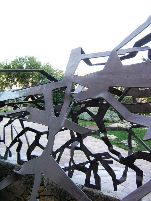 DETTAGLIO SCULTURA IN FERRO INTAGLIATO Dettaglio scultura in ferro intagliato